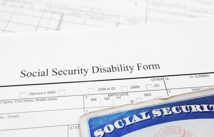The top of a social security disability form and social security card